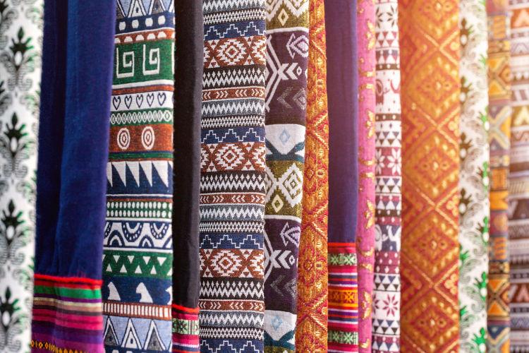 Full frame shot of colorful fabrics hanging at market
