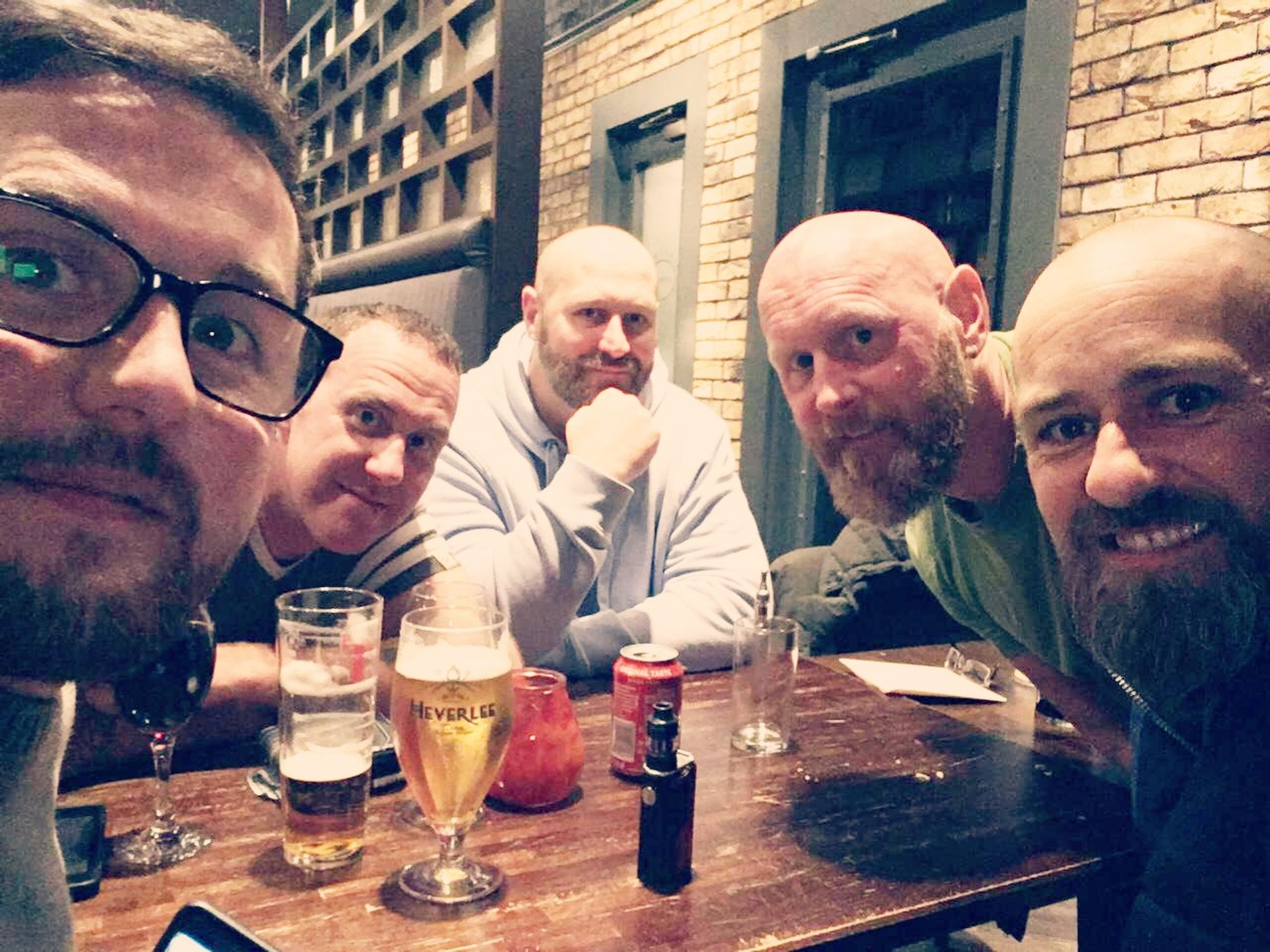 group of people, beard, table, portrait, facial hair, real people, looking at camera, refreshment, young men, men, alcohol, mid adult men, leisure activity, food and drink, front view, lifestyles, drink, people, friendship, glass, mustache