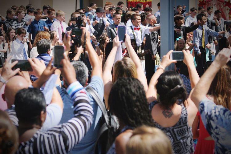 Parent Paparazzi Graduation At School Taking Photos Spirit Family Proud Parents Freestyle A Moment