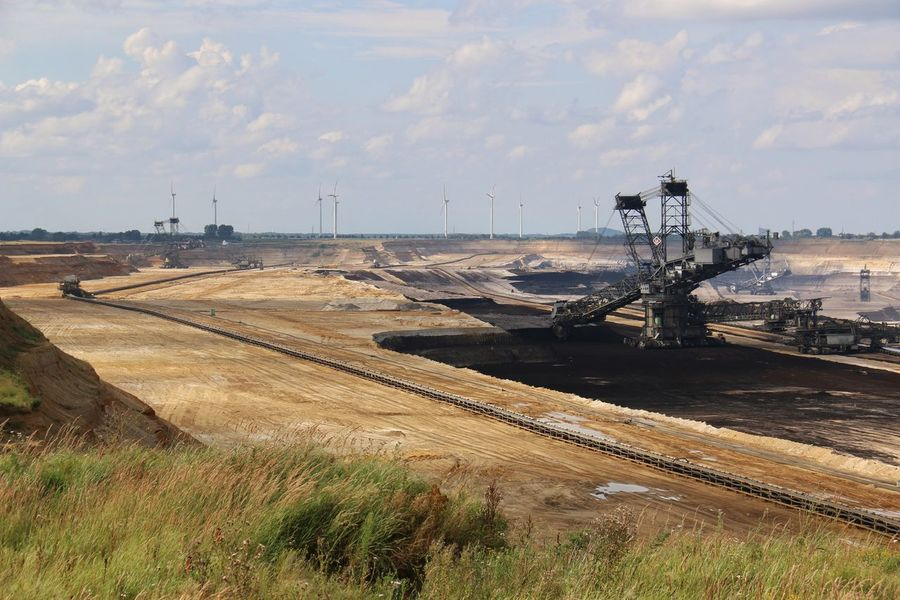 Brown coal surface mining - open cast coal mining. Huge bucket wheel excavator. new developed technology. Supposed to be more environmentally friendly. But villages are abandoned/disappear. Bucket Wheel Excavator Cloud - Sky Day Development Distant Industry Nature Non-urban Scene Open Cast Coal Mining Outdoors Sky The Way Forward Tranquility Live For The Story