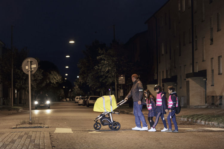 Children playing on street in city at night
