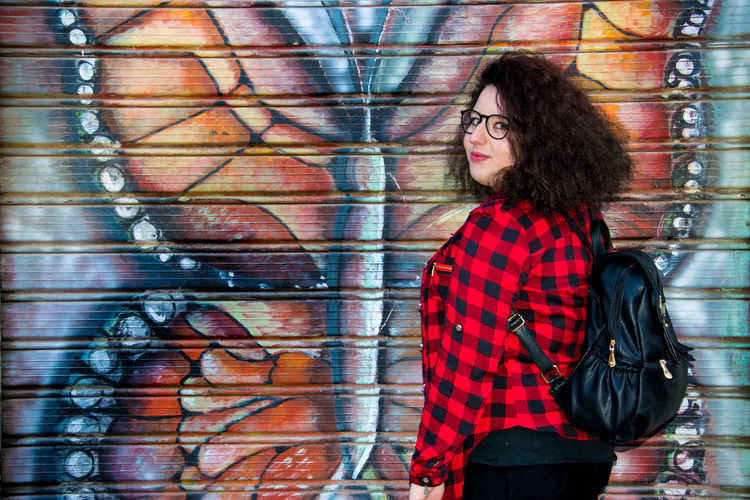 Portrait Young Women Attitude Beard Standing Looking At Camera Fashion Eyeglasses  Cool Attitude Mid Adult Street Art Mural Spray Paint Spray Bottle Fresco Hip Hop Art Vandalism Brick Wall Graffiti Thoughtful Funky