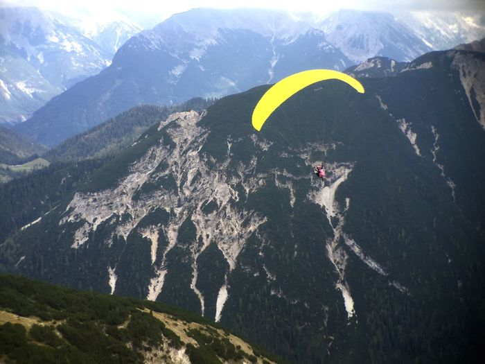 Paragliding in the Mountains . Yellow