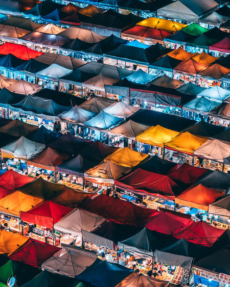 High angle view of multi colored tents at market stall in city during night