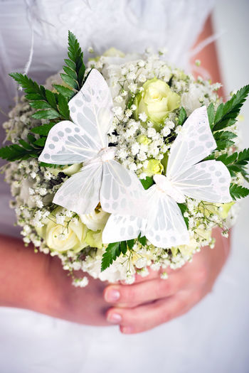 Beautiful bridal bouquet decorated with butterflies Beautiful Beauty Bouquet Bridal Bouquet Bride Bunch Of Flowers Butterfly Close Up Close-up Flower Flowers Freshness Holding Human Body Part Human Hand Leaf One Person People Roses Summer Wedding Wedding Dress Weding White Color Women