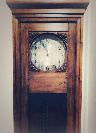 Close-up of clock on door