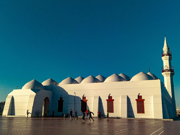 Teenager spent the day before sunset playing football at qishos mosque in jeddah, arab saudi