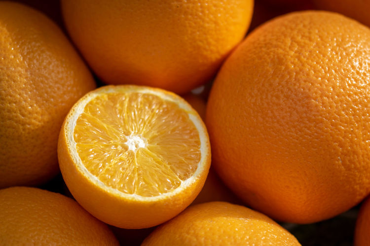 Orange Backgrounds Citrus Fruit Close-up Cross Section Food Food And Drink Freshness Fruit Full Frame Group Of Objects Healthy Eating Indoors  Juicy No People Orange Orange - Fruit Orange Color Ripe Still Life Vitamin C Wellbeing