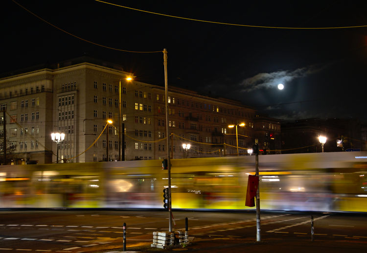 Frankfurter Tor Full Moon Fulmoon Nightphotography Tram Architecture Berin Blurred Motion Building Exterior Built Structure City Illuminated Light Trail Long Exposure Mode Of Transport Motion Night No People Outdoors Public Transportation Rail Transportation Sky Speed Street Light Transportation