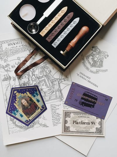 Ticket Wax Stamp Harry Potter ⚡ Harry Potter World Kings Cross Night Bus Harry Potter Indoors  Text High Angle View No People Western Script Still Life Communication Close-up Paper Table Arts Culture And Entertainment Creativity
