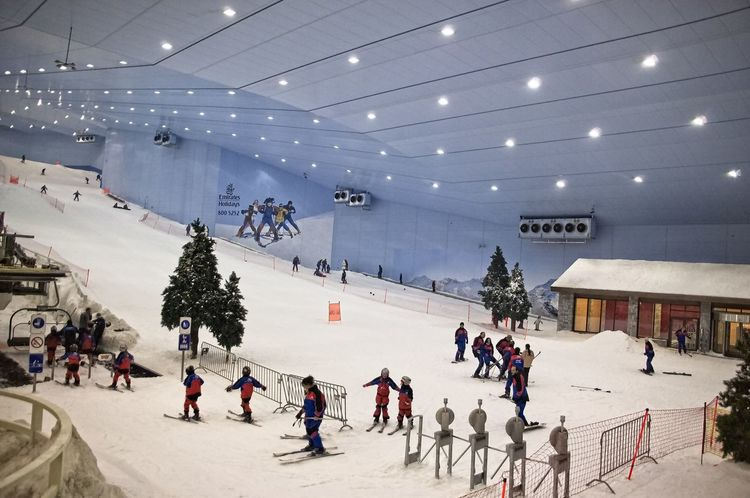 Indoor ski hall in Mall of Emirates, Dubai, UAE. Dubai Skiing UAE Architecture Artificial Snow Artificial Snow Ski Slope Built Structure Cold Temperature Indoor Ski Track Indoors  Large Group Of People Leisure Activity Lifestyles Mall Of Emirates Men People Real People Snow Sport Warm Clothing Winter Winter Sport