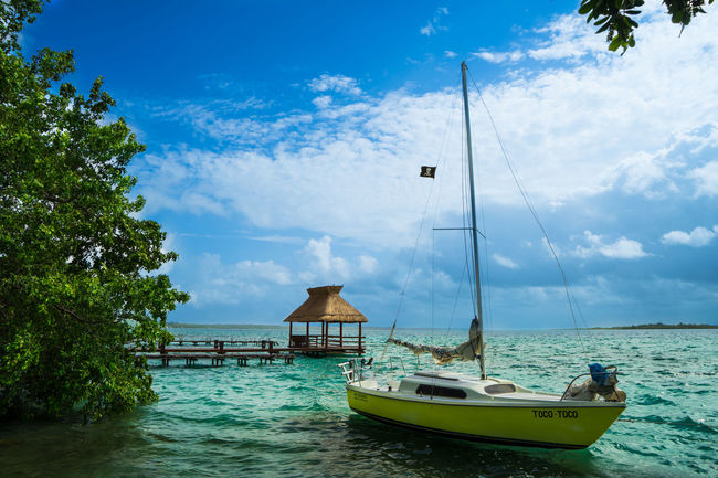 Bacalar Bacalar Lagoon Mexico Pirate Pirates Quintana Roo Beauty In Nature Boat Cloud - Sky Colores Day Horizon Over Water Lagoon Mode Of Transport Moored Nautical Vessel Paradise Sail Scenics Sea Sky Transportation Tree Water Wind One Step Forward Summer Exploratorium