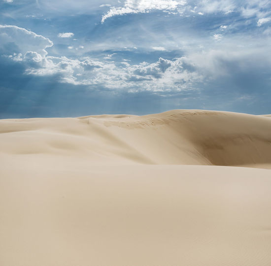 Proportions Australia Desert Dramatic Sky Dunes Abstract Blue Sky Clouds And Sky Contrasting Colors Desert Dramatic Clouds Dunescape Fading Landscape No People Peaceful Proportions Sand Sand Color Sand Dune Sand Dunes Scenics Stockton Dunes Storm Cloud Sun Beam Sunlight