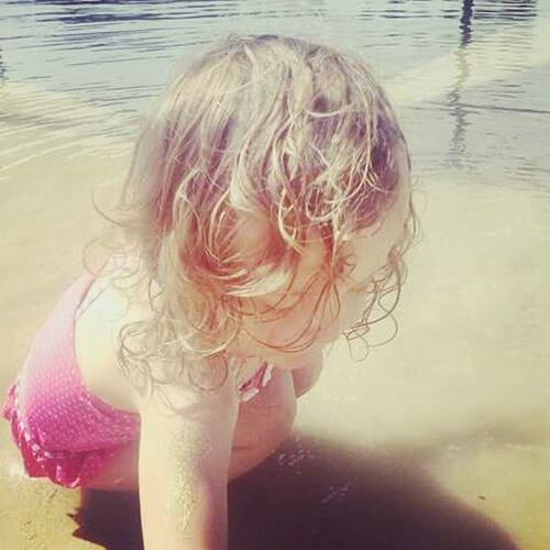 Swimming Lake Lakeside Sand Bathers Young Girl Toddler  Curly Hair Child Blond Hair Water Wet Childhood Beach Day One Girl Only Outdoors Water Surface Water Reflections Summer Days One Person Close-up Ripples In The Water EyeEmNewHere EyeEmNewHere