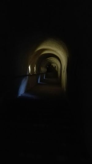 Forte Di Bard Scalinis Fort De Bard Stairways Arch Dark Narrow Corridor Le Petit Chemin La Nuit Tous Les Chats Sont Gris Même Pas Peur Pietra Pierres Indoors  The Way Forward Arch Dark Architecture Long Diminishing Perspective Illuminated Corridor Arched Vanishing Point Le Petit Chemin