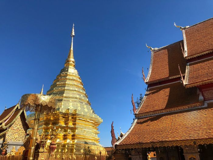 Buda Doisuthep Check This Out Built Structure Architecture Religion Building Exterior Belief Building Place Of Worship Nature Outdoors Travel Travel Destinations No People Spire  Sky Low Angle View Pagoda Spirituality Blue Clear Sky Tower