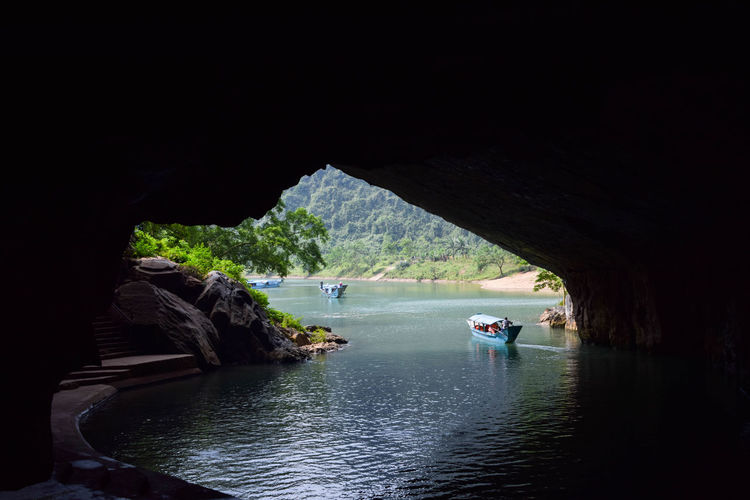 Phong Nha cave entrance Boat Reflection Travel Travel Photography Water Nautical Vessel Tree Arrival Natural Arch Cave Rock Formation Rock Geology