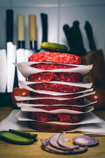 Close-Up Of Burger Patties On Table