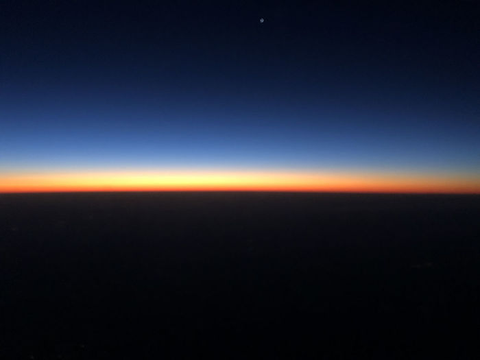Aerial view of Venus during sunrise from airplane. Peaceful Absence Aerial View Above High Angle View Morning Tranquility Blue Sky Orange Sky Outdoors Sunrise Dark Planet - Space Landscape Horizon Over Land No People Horizon Space Atmospheric Mood Stratosphere Astronomy Abstract Twilight Copy Space Venus