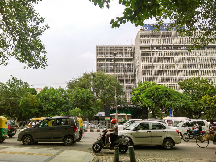 Delhi Police Headquarter Car Tree Transportation Mode Of Transport Day Land Vehicle Outdoors City People Adults Only Adult Sky Delhi Police Headquarters