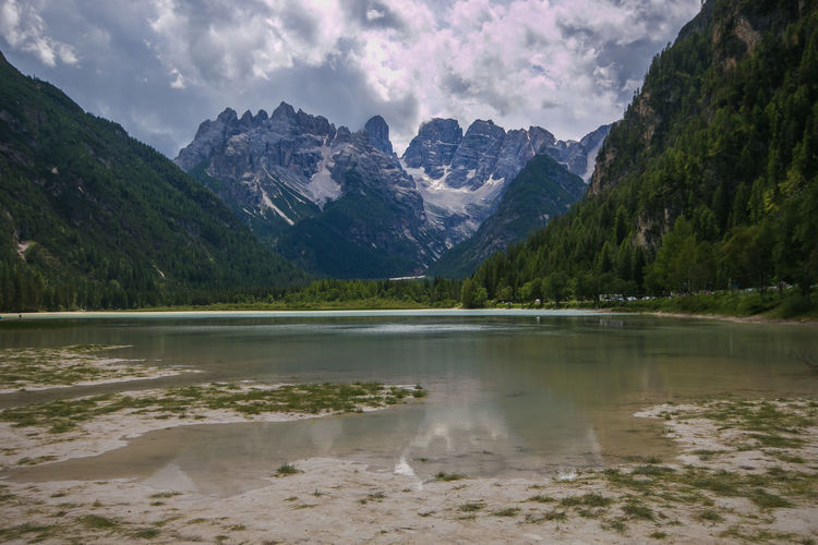 Beautiful mountain lake Landro in Dolomites Alps, Italy Dolomites Dolomites, Italy Travel Trentino Alto Adige Beauty In Nature Cloud - Sky Dolomiti Environment Lago Di Landro Lake Landscape Mountain Mountain Range Mountains Nature No People Non-urban Scene Peak Reflection Scenics - Nature South Tyrol Summer Tranquil Scene Travel Destinations Water