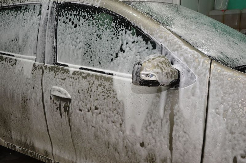 Close-up of wet car