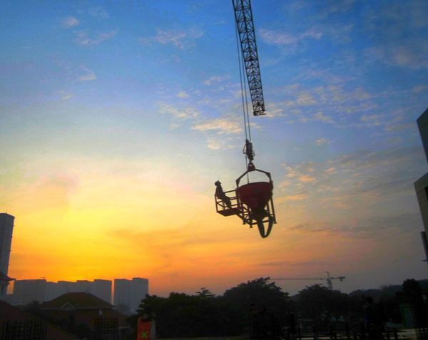 The Secret Spaces Low Angle View Cloud - Sky Sky Silhouette Outdoors City Crane Morning Sky Taking Photo Man At Work Beauty First Eyeem Photo Only Men Mid-air Buildings Sky Colors Sunset No People Day Sky Colours INDONESIA Jakarta Indonesia