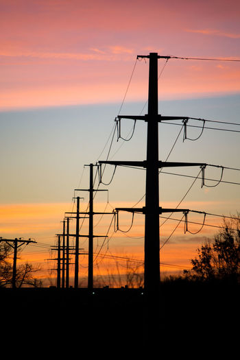 Power line at sunrise Connection Connections Dramatic Sky Electricity  Electricity Pylon No People Power Line  Silhouette Sky Sunrise Silhouette Sunset Technology Technology Everywhere