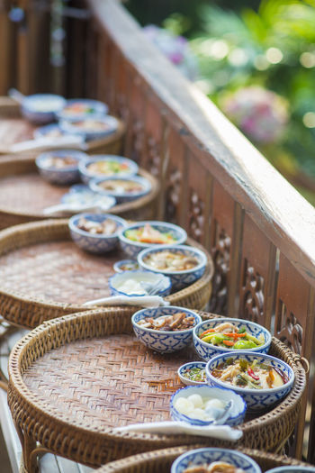 High angle view of food served in bowls on wicker basket