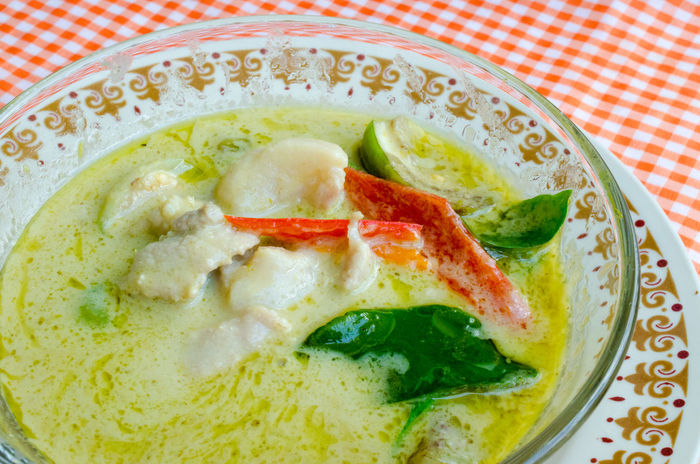 Green Curry with pork in glass bowl. Thai cuisine. Asian Food Bowl Brinjal Chili  Close-up Coconut Milk Curry Day Food Freshness Healthy Eating Indoors  Kaffir Lime Leaves Meat Dish No People Plate Pork Ready-to-eat Savory Food Soup Sweet Basil Leaf Tablecloth Thai Food Traditionalfood Vegetable First Eyeem Photo