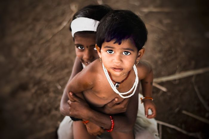 """""""He is my lion king"""" Child Portrait Childhood People Cultures Two People Outdoors Utsavdoshiphoto Looking At Camera Low Angle View FreshonEyeem Innocence Cute♡ Close-up Jesus Loves You Girl Humans Of Dhasai HumansMagazine Photooftheday Babyhood EyeEmNewHere Uniqueness"""