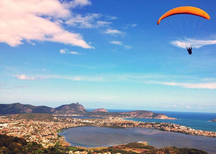 Paraglider over city