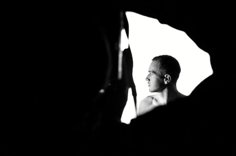 Portrait of silhouette woman against black background