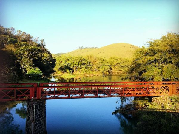 Tranquil Scene Sky Orange Color Mountain Connection Bridge - Man Made Structure Architecture Built Structure Clear Sky Tranquility Scenics Bridge Travel Destinations Water Tourism Mountain Range Blue Beauty In Nature Day Engineering (null)Remote