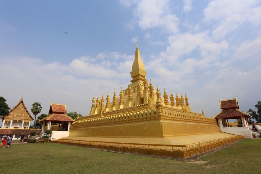 Laos, Vientiane, Pha That Luang Buddhism Stupa Built Structure Architecture Sky Building Exterior Religion Belief Building Place Of Worship Spirituality Travel Destinations Outdoors Cloud - Sky