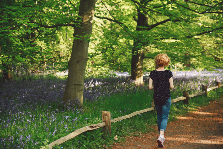 Beauty In Nature Blonde Bluebells Casual Clothing Curly Hair Day Footpath Full Length Girl Grass Green Color Growth Leisure Activity Lifestyles Nature Nature Outdoors Park Path Rear View Spring Tranquil Scene Tranquility Tree Tree Trunk EyeEm LOST IN London Postcode Postcards