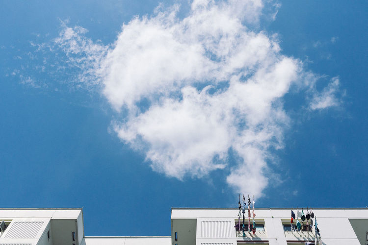 Abstract Architecture Beauty In Nature Blue Building Built Structure Cloud Cloud - Sky Cloudy High Section No People Sky Smoke Sunny White