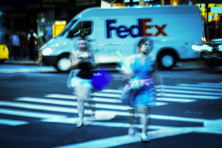 Blurred motion of woman on road