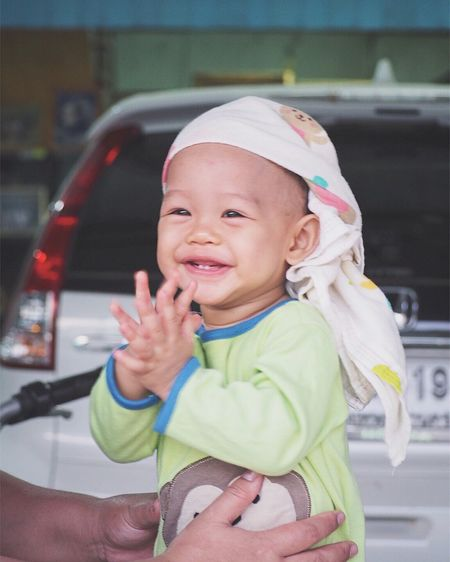 EyeEm Selects Real People Childhood Lifestyles One Person Baby Cute Land Vehicle Focus On Foreground Leisure Activity Day Cap Outdoors Portrait Human Hand Close-up People Kidsphotography Happy