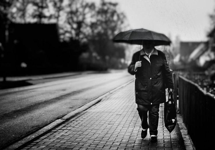 View Of Man Walking In Rain