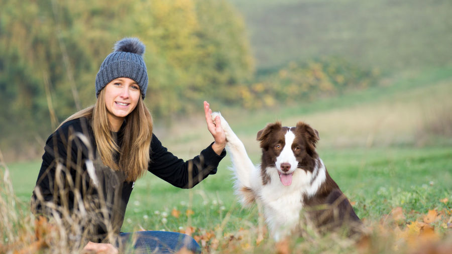 Woman in autumn with dogs in nature Domestic Domestic Animals Pets Dog Animal Themes Mammal One Animal Canine Animal Young Adult One Person Smiling Happiness Adult Long Hair Casual Clothing Hairstyle Three Quarter Length Plant Hair Warm Clothing