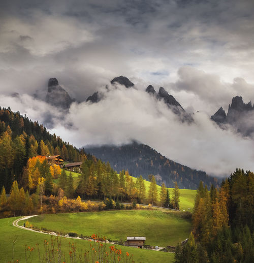 Scenic view of landscape against sky in dolomites mountains