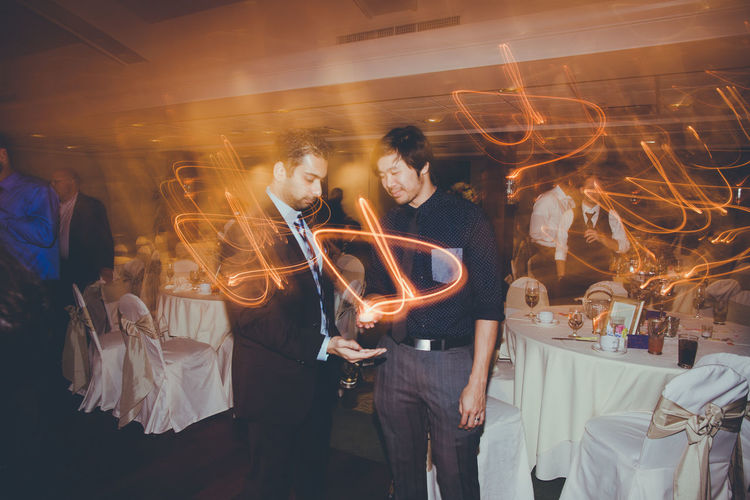 Capturing Movement Wedding Photography Fun Times Light Painting Houston, TX Houston Motion Blur Blur Magic Partying Showing Imperfection