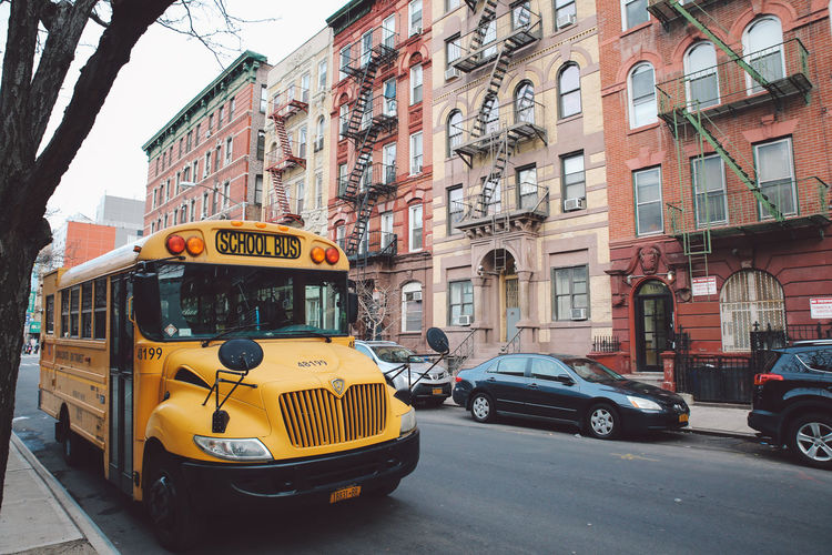 Architecture Building Exterior Built Structure Christmas City City Life Day Land Vehicle New York No People NYC Outdoors School Bus Sky Street Taxi Text Winter Yellow Taxi