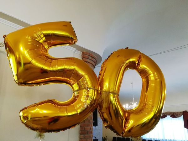 Up In The Air Inflated Balloons Festoon Number Number Fifty Balloons Inflatable Balloons Fifty Years Of Marriage Fifty Party Anniversary Party Anniversary Of Marriage Anniversary Gold Colored Yellow No People Gold Indoors  Day