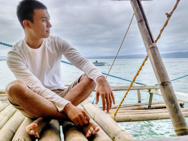 Boat ride on a cloudy day. Eyeem Philippines Sea And Sky White Shirt ThatsMe Mobilephotography Boat Ride Island Hopping Model Pose Portrait Photography Portrait Of A Man  Relaxing Cloudy Day The Portraitist - 2017 EyeEm Awards