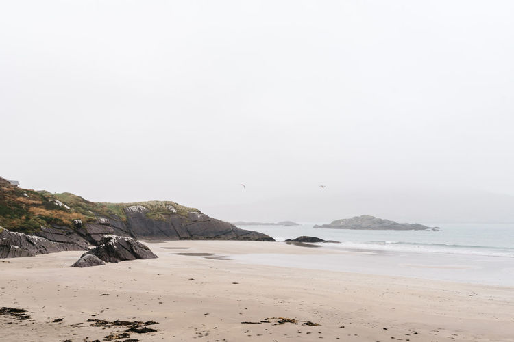 Ireland Misty Wild Atlantic Way Beach Beauty In Nature Clear Sky Copy Space Day Irish Kerry Land Mountain Nature No People Outdoors Ring Of Kerry Rock Sand Scenics - Nature Sea Sky Tranquil Scene Tranquility Water