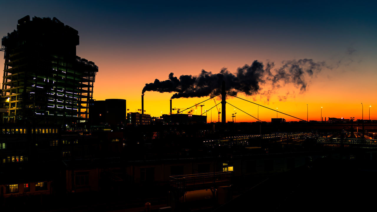 SMOKE EMITTING FROM FACTORY AGAINST SKY AT SUNSET