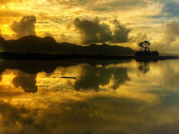 Beauty In Nature Cloud - Sky Idyllic Lake Nature No People Non-urban Scene Orange Color Outdoors Reflection Scenics - Nature Silhouette Sky Sunlight Sunset Tranquil Scene Tranquility Water Waterfront
