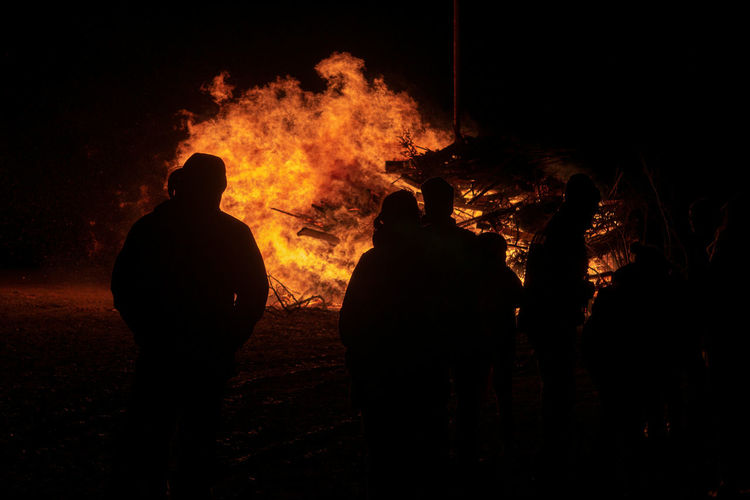 Burning Fire Fire - Natural Phenomenon Heat - Temperature Flame Night Smoke - Physical Structure Silhouette Accidents And Disasters Group Of People Nature Destruction Standing Firefighter Men Dark Bonfire People Occupation Communication